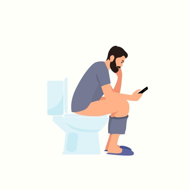 トイレに座って用を足す男性