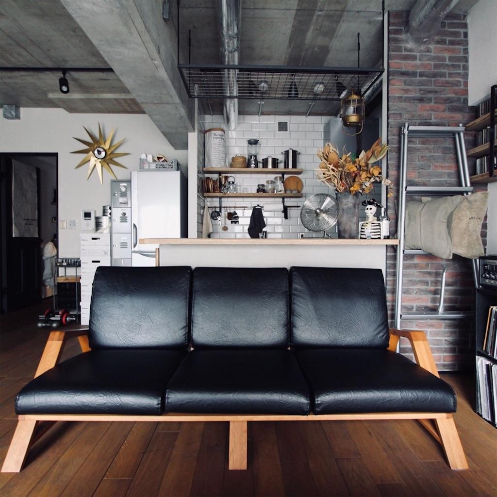 ナラ無垢材とレザーのソファ
